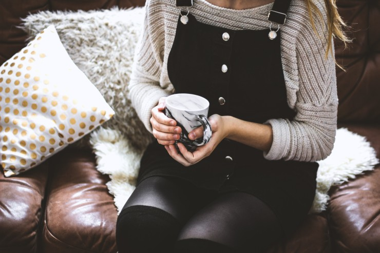mindfulmedicine.co.uk image: Photo of someone holding a cup of tea on a sofa