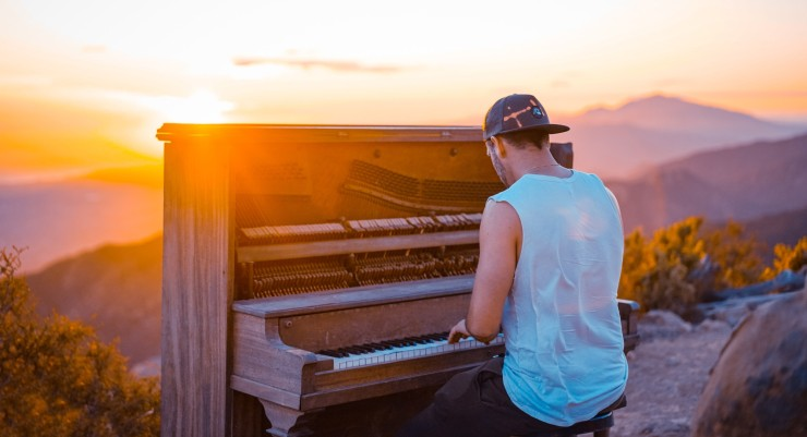 mindfulmedicine.co.uk image: Photo of man playing piano outdoors
