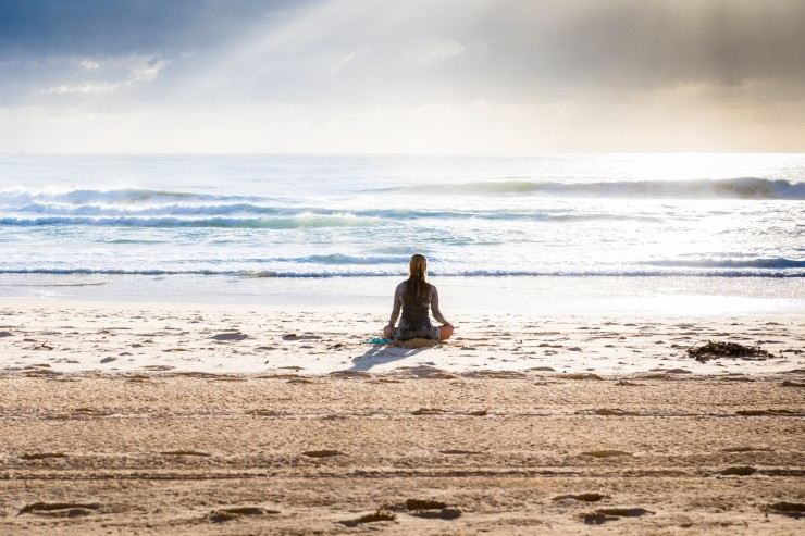 mindfulmedicine.co.uk image: Photo of woman meditating on a beach