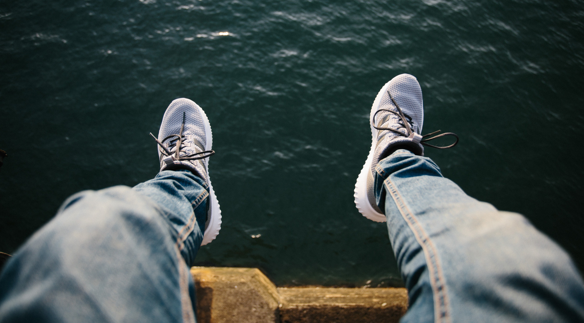mindfulmedicine.co.uk image: Photo of someone dangling their legs over water